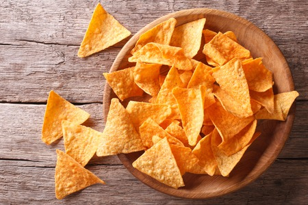 corn chips: Nachos corn chips in the bowl on the table. Horizontal top view Stock Photo