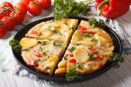 Chopped Spanish omelette with potatoes and vegetables close-up. horizontal 版權商用圖片