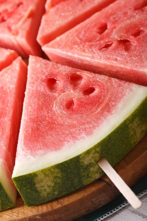 wood stick: slices of fresh watermelon on a stick macro. vertical Stock Photo