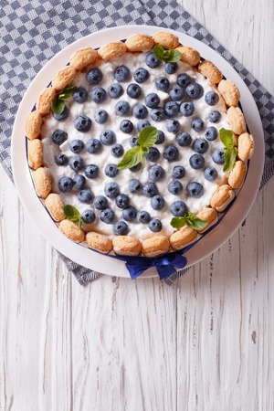cakes: French blueberry cake charlotte with Savoiardi on a plate. vertical top view Stock Photo