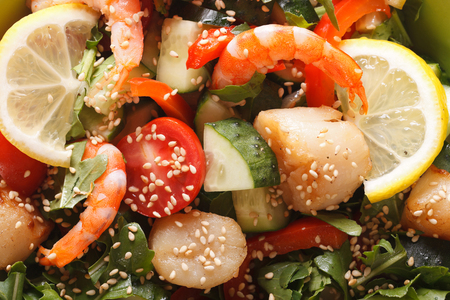 thai food: seafood salad with fresh vegetables macro. background horizontal view from above