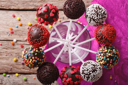 cake ball: Delicious holiday colored cake pops in a glass closeup. horizontal top view