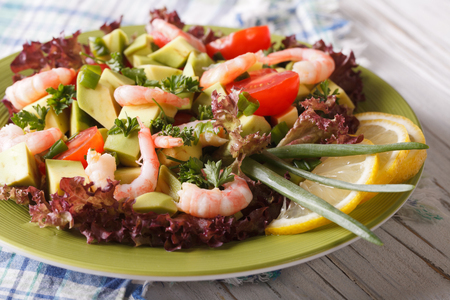 healthy foods: Healthy foods: avocado salad with shrimp and vegetables close-up on a plate. horizontal Stock Photo