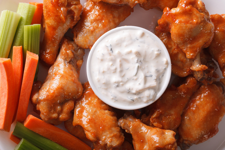 hot wings: Buffalo wings with sauce on a plate macro. horizontal view from above Stock Photo
