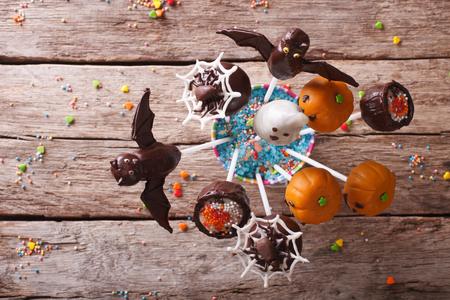 fondant fancy: Festive Halloween pop cakes on a table. horizontal top view