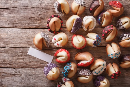 Beautiful fortune cookies decorated with candy sprinkles on the table. horizontal view from above