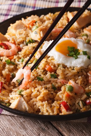 goreng: Fried rice nasi goreng with chicken, shrimp and vegetables close-up