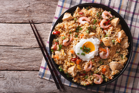 chinese food: Asian fried rice nasi goreng with chicken, prawns, egg and vegetables horizontal view from above