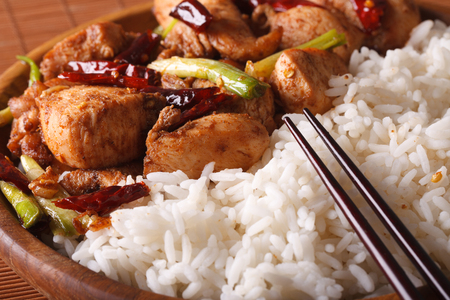 pao: The traditional kung pao chicken and rice on a plate macro
