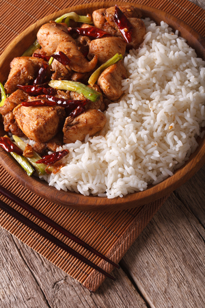 pao: Rice with spicy kung pao chicken on a plate close-up Stock Photo