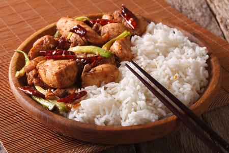 peanut sauce: Chinese Food: Chicken kung pao with rice on a plate close-up