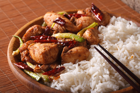 pao: Chinese Cuisine: kung pao chicken and rice on a plate close-up Stock Photo