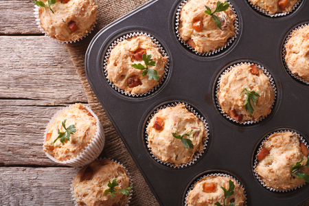 white cheese: homemade muffins with ham and cheese close up in baking dish. Horizontal top view