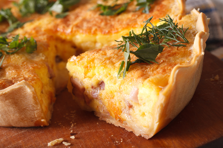 A piece of quiche Lorraine macro on the table