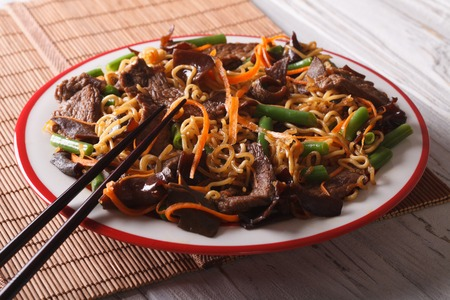 lo mein: Chinese lo mein with beef, muer and vegetables close-up on a plate. Horizontal Stock Photo