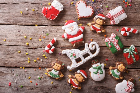 sweet table: Beautiful Christmas gingerbread cookies on a wooden table. horizontal view from above