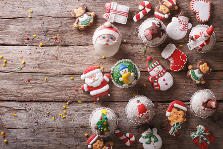 snowman: Background of Christmas sweets on a wooden table. horizontal view from above