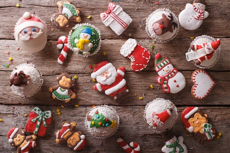 Background of Christmas sweets closeup on a wooden table. horizontal view from above