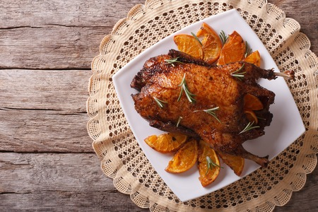 roast duck: Delicious Roast duck with oranges on a plate. horizontal view from above