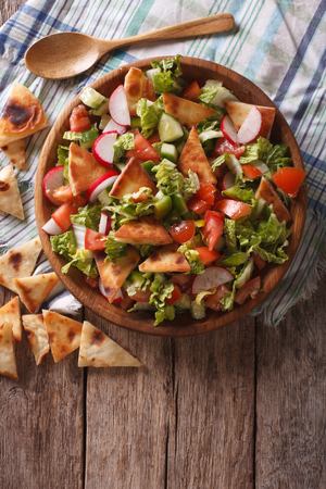 vertical: Traditional Arabic fattoush salad on a plate on the table. vertical top view Stock Photo