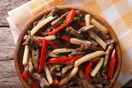 Homemade Peruvian Food: Lomo saltado close-up on a plate. horizontal view from above Stock Photo