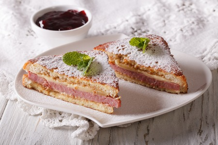 cristo: Delicious of Monte Cristo sandwich and jam on the table. horizontal