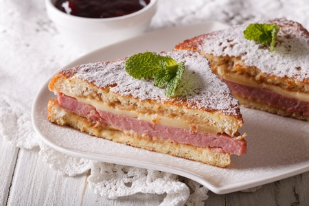 cristo: Monte Cristo sandwich with powdered sugar and mint close-up. horizontal