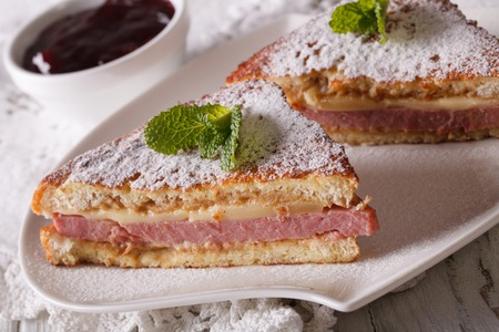 monte cristo: Monte Cristo sandwich close up on a plate and berry jam. horizontal