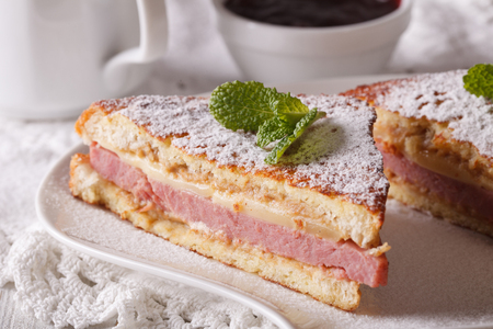 cristo: Sandwich of Monte Cristo with ham and cheese close-up on a plate. horizontal Stock Photo