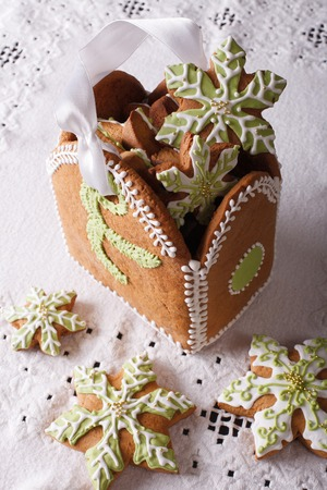 mag: Gingerbread box filled with Christmas snowflake close-up. vertical