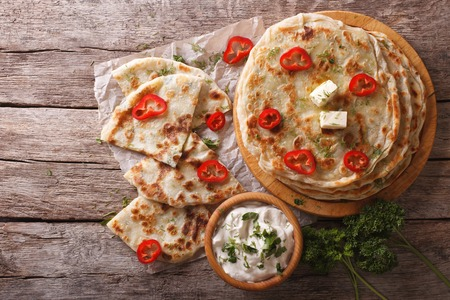Indian paratha stuffed with potatoes on the table. horizontal view from above Stock Photo