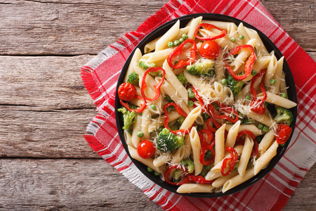 primavera: Primavera pasta with vegetables on a plate on the table. horizontal top view