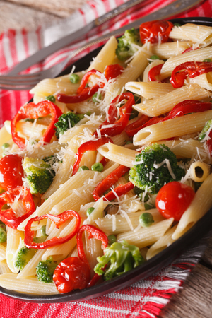 primavera: Italian Pasta Primavera with Parmesan close-up on a plate on the table. vertical Stock Photo
