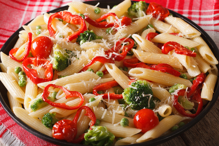 primavera: Pasta Primavera with vegetables close-up on a plate on the table. horizontal