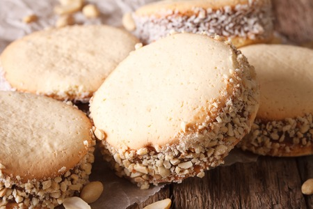 Delicious Alfajores cookies on paper close-up on the table.  horizontal, rustic Stock Photo