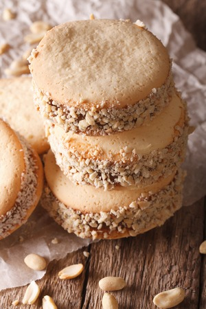 alfajores: Alfajores homemade cookies with on paper on the table macro. Vertical Stock Photo