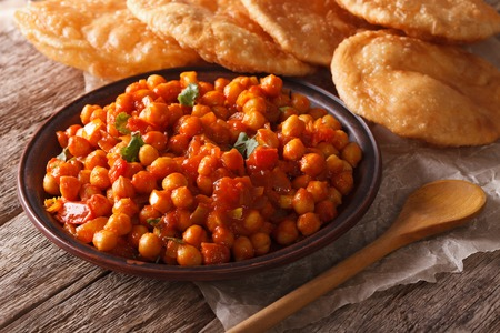 puri: Indian Chana masala and puri bread close-up on the table. horizontal Stock Photo