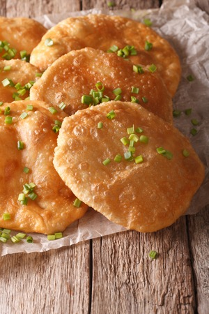 pani: Indian puri bread close-up on a paper on the table. vertical