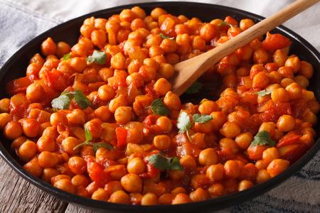 chaat: Indian food: Chana masala closeup on the table. Horizontal