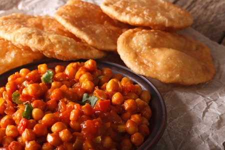 puri: Indian Cuisine: Chana masala and puri bread close-up on the table. horizontal