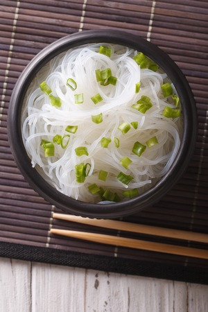 crystal bowl: Asian crystal noodles close up in a bowl on the table. vertical view from above