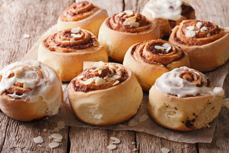 Delicious Cinnabon with almond close up on the table. Horizontal