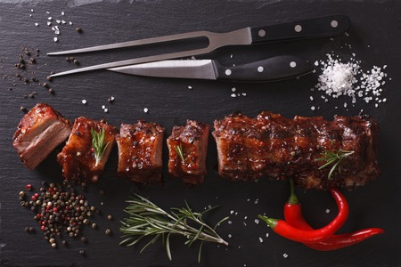 chilli: BBQ pork ribs chopped on a table with the ingredients. horizontal top view