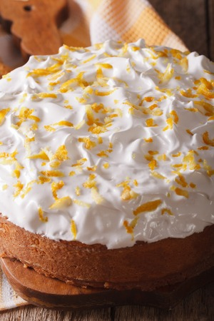 tres: Tres leches cake covered with white icing closeup on a wooden table. vertical Stock Photo
