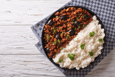 Picadillo a la habanera with rice on the table. horizontal view from above Imagens