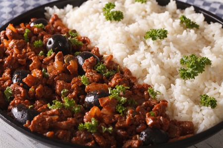 Latin American cuisine: Picadillo a la habanera with a side dish of rice macro. horizontal