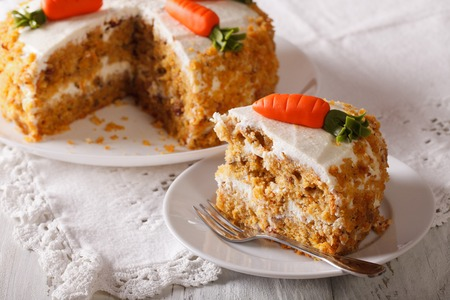 piece of cake: Homemade desserts: sliced carrot cake on a plate closeup. horizontal