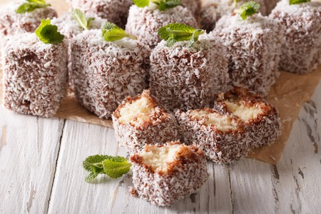 extravagance: Australian Lamington cake decorated with mint close up on the table. Horizontal