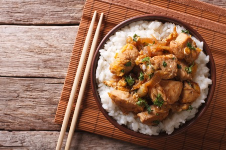 Traditional oyakodon and rice in a bowl on the table. horizontal top view Banque d'images