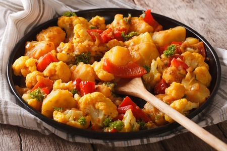 gobi: Gobi Aloo cauliflower and potatoes close up on a plate on the table. horizontal Stock Photo
